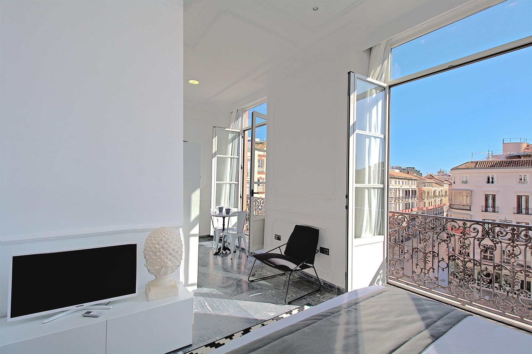 Apartamentos en m laga constituci n i for Alojamiento estancia 25m2